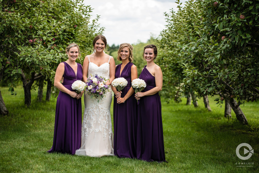 Purple bridesmaid dresses and floral