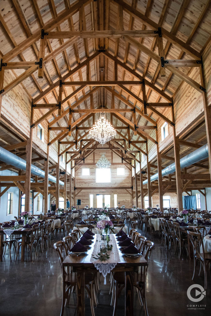 purple wedding barn reception chandeliers