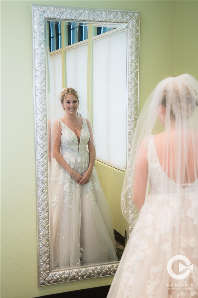 Bride in mirror after getting ready at 13 East Event Center