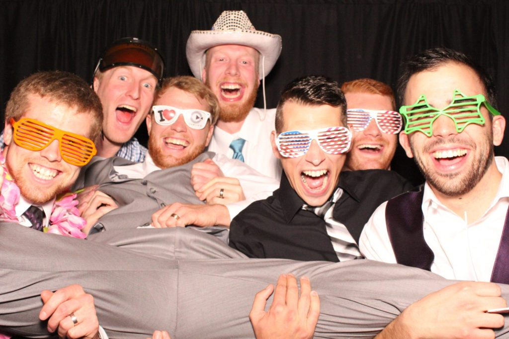 Groom with Guests in Photo Booth