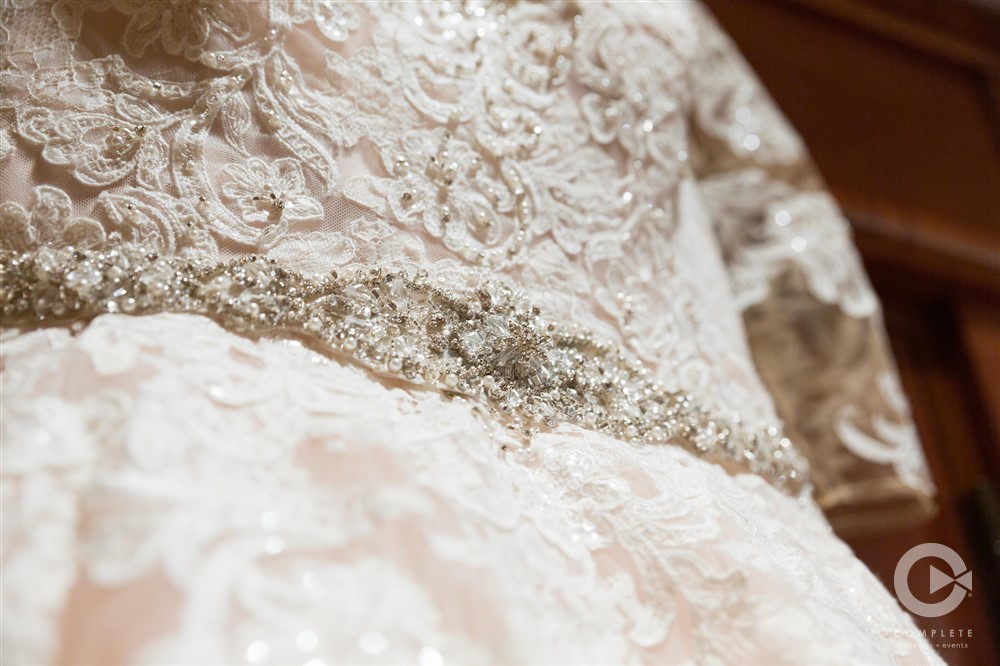 lace wedding gown with beaded belt