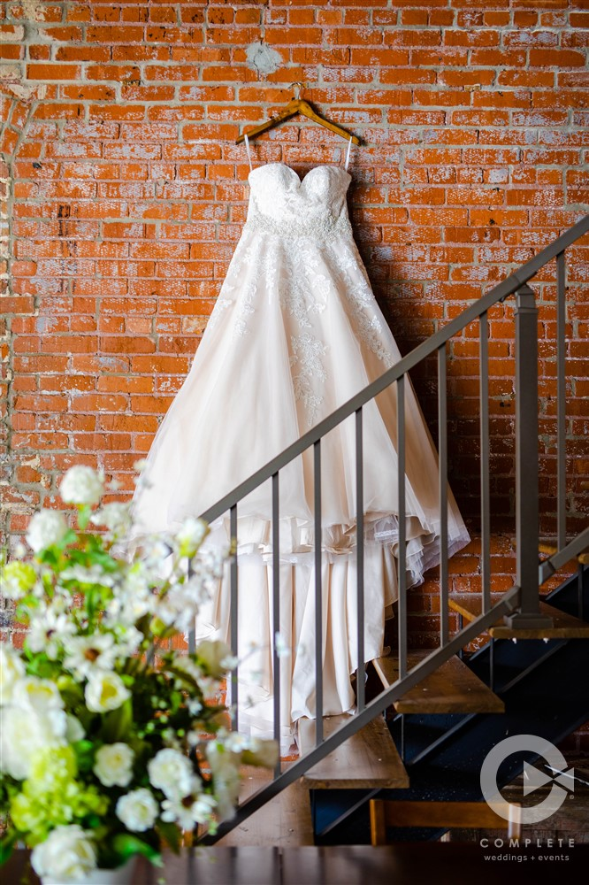 wedding dress hanging over stairs
