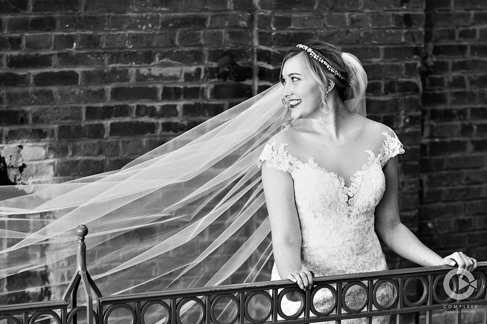Bride in front of Brick Wall