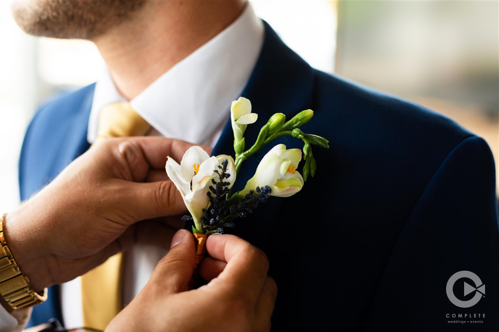 groom with navy